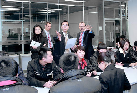 Christoph Nesgen and HGS colleagues at a training in a car dealership in China
