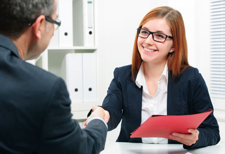 Woman shaking hands with human ressources manager after a job interview