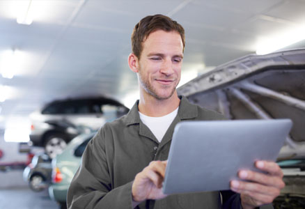 Car service specialist using tablet computer